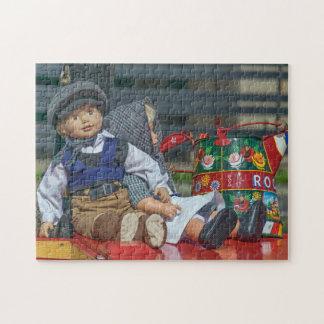 Puppen- und Bewässerungsdosen-Fotopuzzlespiel