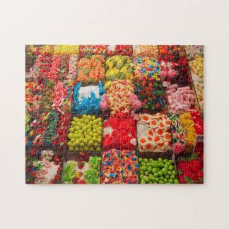 Puzzle des bunten Geschäftes der Süßigkeit süßen