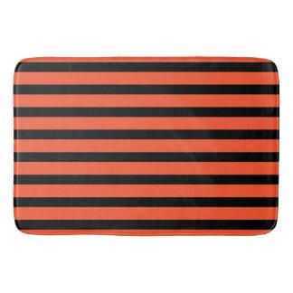 Rétro motif de rayures noires et oranges tapis de bain