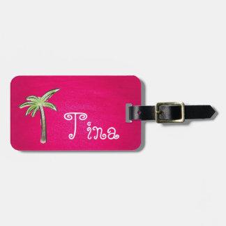 Rosa Gepäckanhänger mit einer Palme