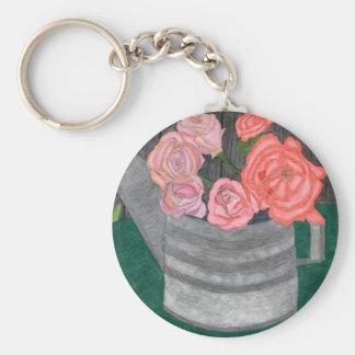 Rosen in der Bewässerungs-Dose Schlüsselanhänger