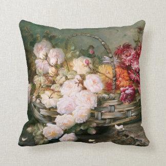 Rosen und Astern in einem Weide-Korb Kissen