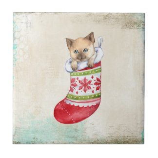 Rote und weiße Socke des Weihnachtsfeiertags mit Kleine Quadratische Fliese