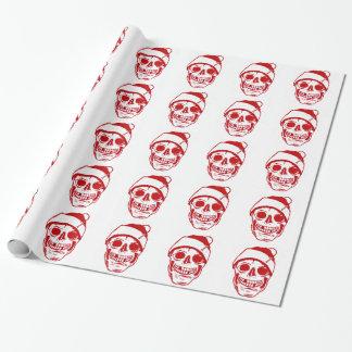 Roter Schädel in der Weihnachtsmannmütze glatt Einpackpapier