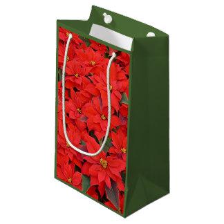 Roter Weihnachtsfeiertags-BlumenFoto der Kleine Geschenktüte