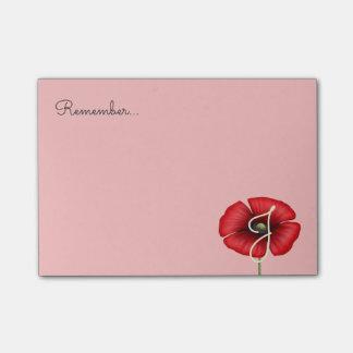 Rotes Mohnblumen-Blumen-Monogramm auf rosa Post-it Haftnotiz