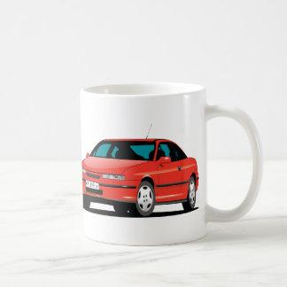 Rotes vorderes Opel Calibras und hinter Tasse