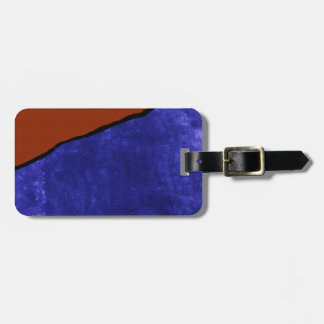 Schmutziger blauer und orange Riss Gepäckanhänger