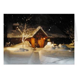 Schnee, der auf Klotz-Haus an der Grußkarte