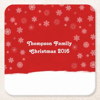 Schneeflocke-Feiertags-Entwurf mit einem roten Kartonuntersetzer Quadrat