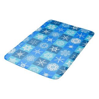 Schneeflocke-Quadrate auf Blau Badematte