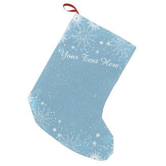 Schneeflocken auf blauem Strumpf Kleiner Weihnachtsstrumpf