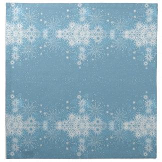 Schneeflocken auf blauen Servietten