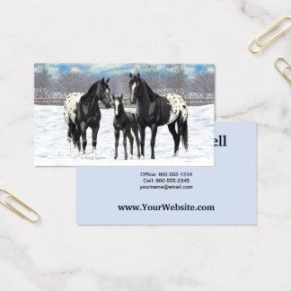 Schwarze Appaloosa-Pferde im Schnee Visitenkarte