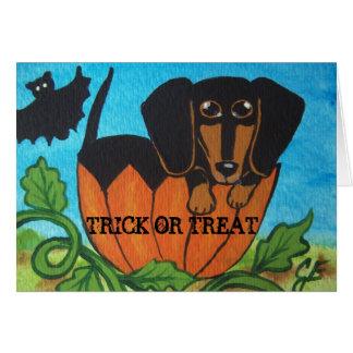 Schwarze Dackel-Halloween-Kürbis-Gruß-Karte Karte