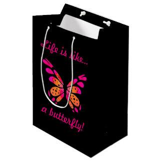Schwarze Geschenk-Tasche mit rosa Schmetterling Mittlere Geschenktüte