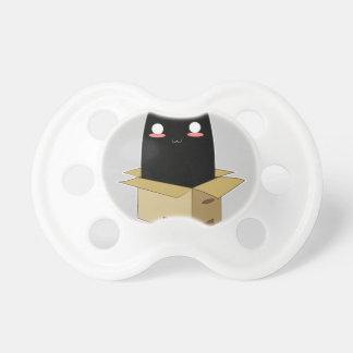 Schwarze Katze in einem Kasten Schnuller