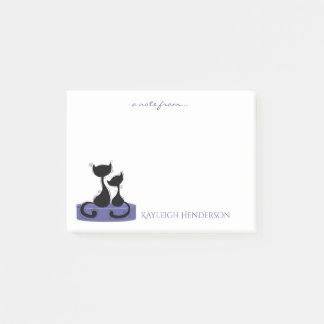 Schwarze Katzen-Silhouette auf lila grünem Post-it Klebezettel