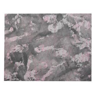 Schwarze Tinte auf rosa Leuchtmarker Schmierblöcke