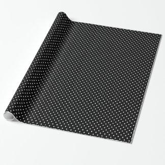 Schwarzer Hintergrund der schicken kleinen weißen Geschenkpapier