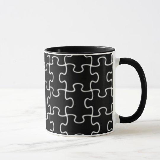 schwarzes Puzzlespielmuster Tasse