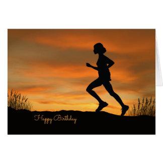 Silhouette-Läufer mit einer Grußkarte