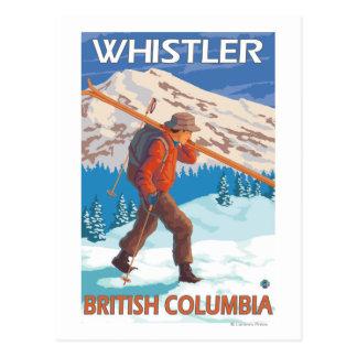 Skifahrer-tragende Schnee-Skis - Pfeifer, BC Postkarten