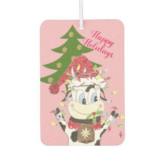 Snowbell, das ihren Weihnachtsbaum verziert Lufterfrischer