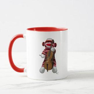 Socken-Affe und Cello Tasse