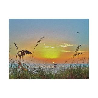 Sonnenuntergang auf dem Strand Leinwanddruck