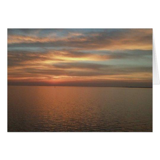 Sonnenuntergang über Ozeananmerkungskarte Mitteilungskarte