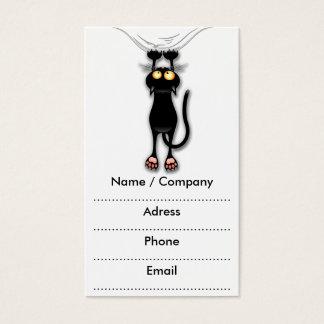 Spaß-schwarze Katze, die unten Visitenkarten fällt