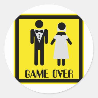 Spiel über Paaren Runder Aufkleber