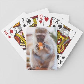 Spielkarten mit vorderem Bild des Affeessens