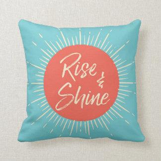 Steigen Sie und glänzen Sie blaues und orange Kissen