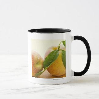 Studio geschossen von den Pfirsichen Tasse
