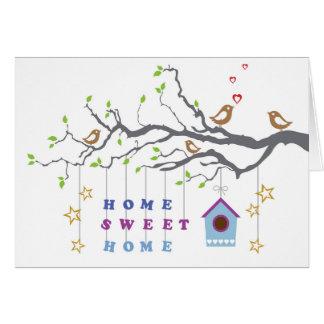 Süßes Zuhause des Zuhause, das in Paargrußkarte Karte