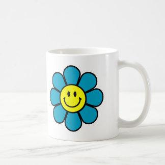 Tasse de café souriante de fleur
