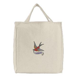 Tätowierungsvogel mit gestickter Tasche der