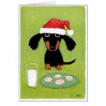 Teckel drôle Père Noël avec du lait et des biscuit Cartes