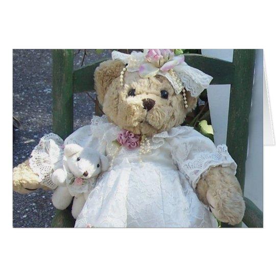 Teddybär mit Hundepuppe in der Stuhl-Gruß-Karte Karte