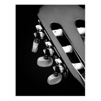 Tête noire et blanche de guitare carte postale