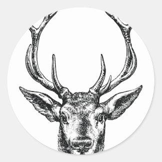Tête vintage de mâle ou de cerfs communs avec des autocollants ronds