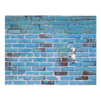 Texture vintage de mur de briques de bleu de ciel carte postale