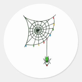 Toile et lumières d'araignée de vacances sticker rond