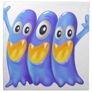 Trois monstres bleus espiègles serviette