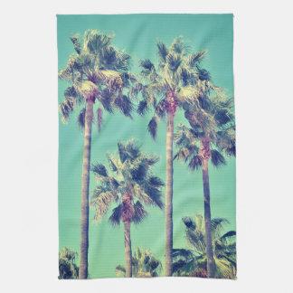 Tropische Palmen auf aquamarinem Geschirrtuch
