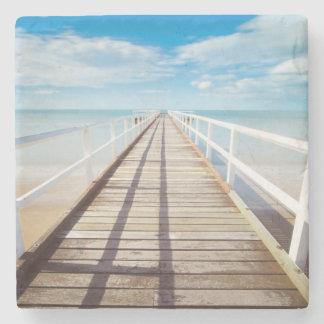 Tropischer Strand-Pier Steinuntersetzer