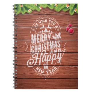 Typografie der frohen Weihnachten und des guten Notizblock