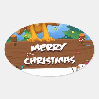 Un ours espiègle jouant près de Noël signboar Sticker Ovale